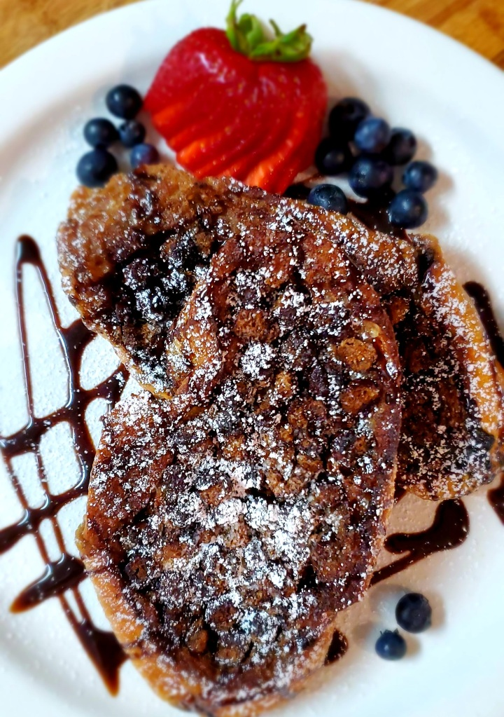 Create the perfect brunch with chocolate puff cereal French toast drizzled with chocolate syrup and a sprinkle of powdered sugar.