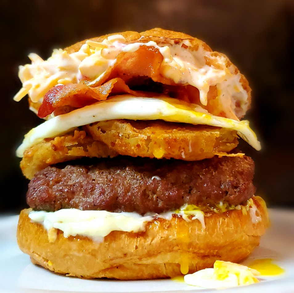 Dripping gooey southern style burger with house-made pimento cheese, fried green tomatoes, maple bacon and a fried egg!