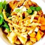 Ethiopian Chicken Fusion Bowl W/ Dueling Potatoes, Shichimi Togarashi Dusted Onion Strings And Cilantro Cream